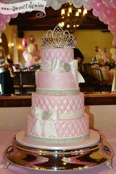 pink princess first birthday cake w/ a tiara, bows and crystals