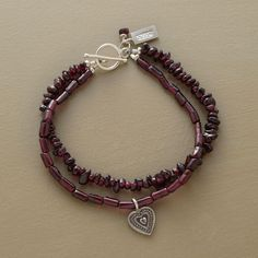 "DOUBLE GARNET BRACELET -- Garnets two ways: one strand of chips another of cylinder beads. The latter dangles a sterling silver heart charm. Toggle clasp. Ours exclusively, handcrafted in USA. Approx. 7-1/2""L."