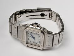 LADIES CARTIER SANTOS  For Sale  STAINLESS STEEL AUTOMATIC  100% Genuine  Size   24,5  excluding crown  Good  working order, gives perfect time