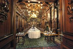 Sumptuous dining room in Peles Castle, in the village of Sinaia, just south of Brasov, Romania