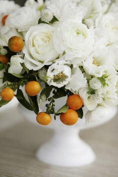 We LOVE this soft take on a 'citrus' arrangement... use white as your backdrop punctuated with zesty orange.