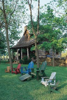 oh so darling tiny log lake house - lovin' those multiple colored chairs!