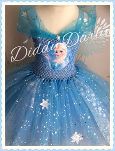 Elsa Tutu Dress. Sparkly Elsa Dress. Frozen Tutu Dress. Queen Dress. Party Dress. Princess Tutu Dress. Anna Dress. Costume.  Beautiful & lovingly handmade.  Price varies on size, starting from £25.  Please message us for more info.  Find us on Facebook www.facebook.com/DiddyDarlings1 or our website www.diddydarlings.co.uk
