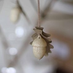 wooden acorns hanging winter woodland wedding decorations available from Wedding Decorations For Sale, Christmas Tree Decorations, Hanging Decorations, Christmas Ornaments, Table Decorations, Winter Wedding Favors, Unique Wedding Favors, Winter Weddings, Bridesmaid Gifts