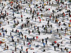 Anglers cast lines through holes in a frozen river during Hwacheon Sancheoneo, or Mountain Trout Ice Festival, in Hwacheon-gun, South Korea. The annual event draws thousands of visitors, who compete in a fishing competition with traditional lures or their bare hands. Photograph by Chung Sung-Jun, Getty Images, January 25, 2015