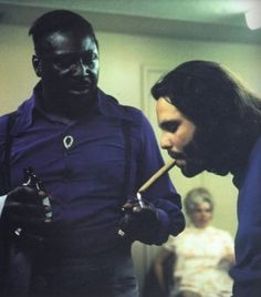 Left: Albert King with Jim Morrison and Robby Krieger, backstage at a June 1970 Vancouver show where Albert shared billing with The Doors. Right: Albert King lights Jim Morrison's fire. Blues Rock, Recital, Instrumental, Rock Music, My Music, Music Stuff, Beatles, Ray Manzarek, Jimi Hendricks