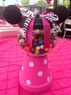 Mini mouse gum ball machine made out of a ceramic pot, Styrofoam balls for ears, paint, and a fish bowl. Just add gym balls to complete the look!