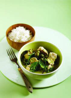 Make a traditional Thai green chicken curry with this recipe using galangal, pea aubergines and Thai basil.