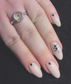 nude almond nails with rhinestone accent nail art