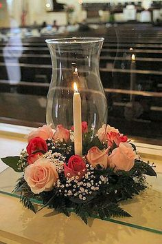 Centerpiece Featuring Hurricane Glass, Roses and Baby's Breath