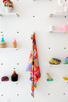"""This Is How You Open Your Own Store At 24 #refinery29 http://www.refinery29.com/objectify-store-tour#slide7 """"The same goes for the wall of objects; it's kind of modular. The grid on the wall came about because I've always been kind of bad with a level, and I wanted an easy way to know that things were hung straight. Basically, I let my aesthetic show while keeping things functional."""""""
