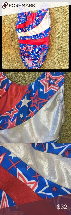 """Stars & Stripes Gymnastics Leotard - Petite Adult Stars & Stripes Gymnastics Leotard   Size: PA (Petite Adult)  You'll be the epitome of patriotic in this red, white & blue gymnastics stunner! The stripes have a metallic finish and the star patterned background is slightly more muted. This leo size states """"Petite Adult"""", but my daughter was 9-10 years old when she wore it.  80% Nylon 20% Spandex  Made in the USA  Very Good Used Condition Motion Wear Other"""
