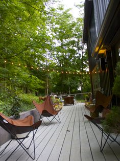 Modern back deck,cafe lights and butterfly chairs. Patio