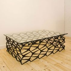 Cast iron fence turned table by Uhuru in Brooklyn.