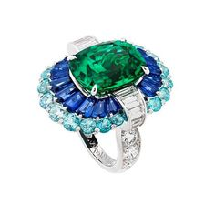 This gorgeous cocktail ring is made of dreams.  From Van Cleef & Arpels, the enduring combination of emeralds, sapphires and aquamarine floating like a dress in this ring is making us swirl in euphoria. - - - #thegemdialogue #sapphires #emeralds #aquamarine #ring #picoftheday #instalove #vancleefarpels #love #exceptional