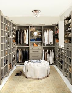 Ballard Designs - Fabulous walk-in closet features taupe shoe cubbies flanking taupe storage towers as well as Margeaux Ceiling Mount Chandelier over  Ballard Designs Hayes Round Tufted Ottoman.