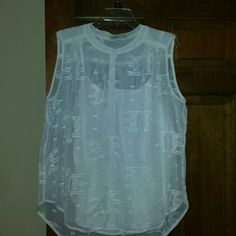 Chaus white sheer top Beautiful white sleeveless top by Chaus with built in white tank. Tiny little snaps button up the front. Only worn twice, in mint condition. 100% polyester, machine wash chaus Tops Blouses