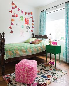 Virginia Johnson's daughter's room incorporates an antique four-poster bed from the Ontario hamlet of Caledon, antique kantha-quilt bedding from India and a cheery polka-dot bunting. Design: Virginia Johnson Photo: Alex Lukey