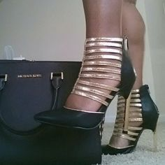 Black and gold shoes These black and gold sandals are hot and a must have in your shoe collection! Brand new in box! Shoes