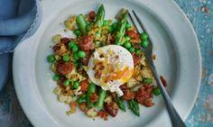 "Sautéed peas and asparagus with poached egg and ""chorizo migas""."