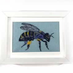 A personal favorite from my Etsy shop https://www.etsy.com/listing/489104743/framed-bee-art-honey-bee-art-bee-nursery