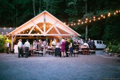 Hawkedene - a destination wedding venue in the Great Smoky Mountains of Western North  Carolina - and its reception setting for an evening celebration.