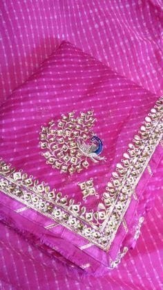 Mothda saree with danka patti wrk on it.