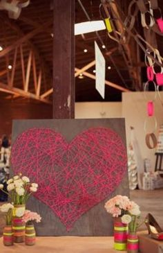 I could see this being an inventive take on the wedding guest sign-in, by having guests wind the string/yarn themselves and affix signed tags to their portion of the design....