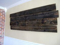 Idea for hinged art display: turn these wood panels vertical (ignore the words on them) then hinge 2 or 3 together.
