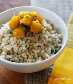 Brown Coconut Rice with Cilantro - Coconut milk, brown rice, coconut flakes, fresh ginger and cilantro are combined to create this simple side dish, perfect to accompany many Thai dishes.