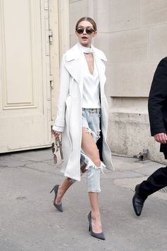 Hadid shows off some serious leg in one x oneteaspoon distressed denim, adding an elegant effect with a silky white top, A.L.C. coat and pointy gray heels.