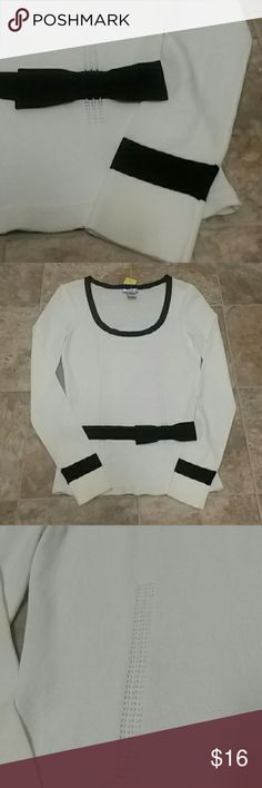 White sweater with classic black details NWOT. Super classy sweater made from very nice nylon knit. The understated but pretty bow detail at the waist makes this anything but ordinary. Notice the knit detail along both sides of the front.  This sweater is from a little boutique brand. Hand washable. 10409. Cache Sweaters Crew & Scoop Necks