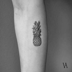 Fine line style pineapple tattoo on the right inner forearm.