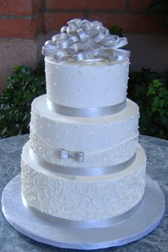 Lovely White tiered cake with gray details