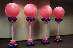 Pink and purple balloon columns