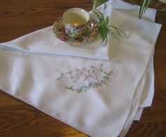 Vintage off white cotton in x 35 in,embroidered tablecloth,pink and yellow embroidered tablecloth at Designs by Willowcreek on Etsy by DesignsByWillowcreek on Etsy Picnic Tablecloth, Wedding Tablecloths, Shabby Cottage, Embroidered Flowers, Vintage Home Decor, White Cotton, Off White, Vintage Items, Handmade Gifts