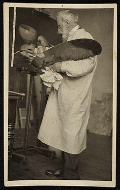 William Merritt Chase at work in his studio, ca. 1910
