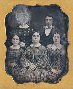 Family daguerrotype with one woman's face obliterated. Think somebody had feelings about her stepmother? Or was that the daughter who defied Father and ran off?