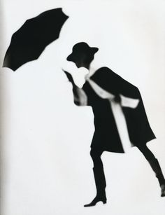 Model wearing a black and white coat, 1950. Photo by Lillian Bassman