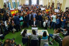 President of Catalonia Artur Mas casts his vote as members of the ultra-right wing Spanish political party VOX hold up spanish flags and banners at a polling station on September 27, 2015 in Barcelona, Catalonia. The main Catalanist parties, Catalan Democratic Convergence 'Convergencia Democratica de Catalunya' party (CDC), Republican Leftist of Catalonia 'Esquerra Republicana de Catalunya' party (ERC) and a group of social associations have joined together.