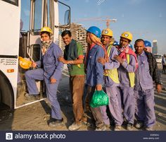 construction-workers-queuing-to-get-on-bus-to-living-quarters-at-end-EGRAHJ.jpg (1300×1110)