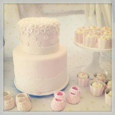 pretty in soft pink. baptism cake with matching cupcakes and fondant floral booties. fondant flowers. fondant booties. floral cake. baptism cake for girl. baptism cake. christening cake for girl