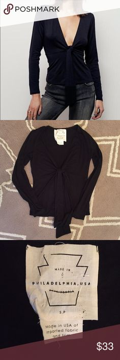 "NWOT Free People Black Stella Plunge Top Sz S 🔹Free People  🔹Stella Plunge Top  🔹Made in Philadelphia. Long sleeve top,  cropped to the natural waist. A plunging neckline w/ a tie accent in a stretchy fit.  🔹Size S  🔹Viscose & spandex  🔹New without tags! Tag marked out to prevent returns.  🔹Bust: 16.5"" across the front, lying flat. Has stretch.  🔹Length: 21.5"" from shoulder to hem.  ✳️Bundle to Save 20%! ❌No Trades, Holds, PP, Modeling 🎀100% Authentic!  ⭐️Suggested User • 1400…"