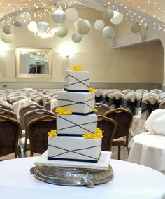 4 tier, fondant daffodil flowers, square wedding cake - passion fruit, lemon, chocolate and salted caramel and vanilla sponges....