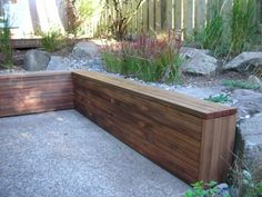 A small retaining wall that would work for us. Could use old book case to store stuff on other side.