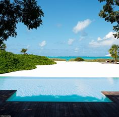 Parrot Cay, a luxury private island resort in Turks and Caicos, draws plenty of famous visitors to its crystal-clear waters, whitewashed villas and laid-back Caribbean atmosphere without guests having to worry about paparazzi