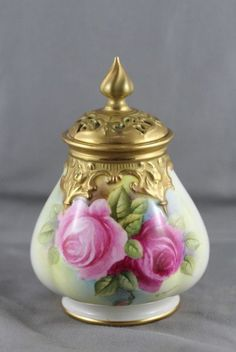 Royal Worcester potpourri vase and cover, baluster body with pierced cover, hand painted with roses by John Tansell in tones of green and pink. Signed Tansell. Shape H291.