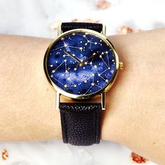 Constellation Watch. The quirky design is available in a choice of black or blue strap, all with gold and silver plated finishing. This watch has a Quartz movement and is water resistant.