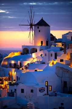 Oia ( Ia ) Santorini - Windmills and town at sunset, Greek Cyclades islands - Photos, pictures and images Santorini Island, Santorini Greece, Paros Greece, Athens Greece, Places To Travel, Travel Destinations, Places To Go, Beautiful Places To Visit, Wonderful Places
