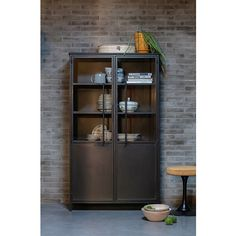 This contemporary display case is from the collection of the Dutch brand BePureHome and is made of black iron with a matte appearance. The doors are made of black metal with hardened glass and have a robust handle. The interior of Exhibit is equipped with Black Display Cabinet, Cabinet Accessories, Retro Cabinet, Black Shelves, Tall Cabinet Storage, Traditional Dressers, Metal Display, Display Cabinet, Coat And Shoe Rack